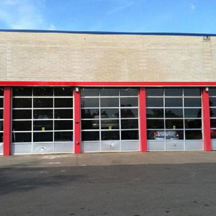 Commercial Door Installation   Belle Tire White Lake MI & Garage Door Springs   Overhead Door West